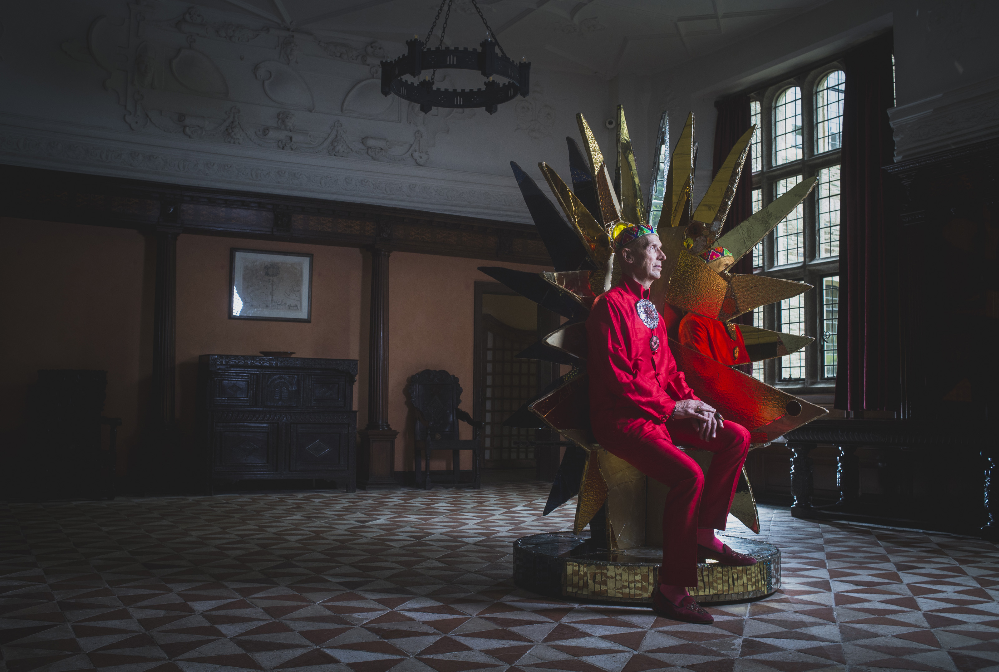Andrew Logan with his sculpture 'Universe Throne' part of 'The Art of Reflection', at Buckland Abbey.